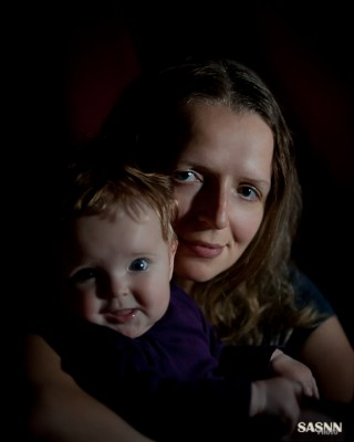 Playing with light. Mother and her child